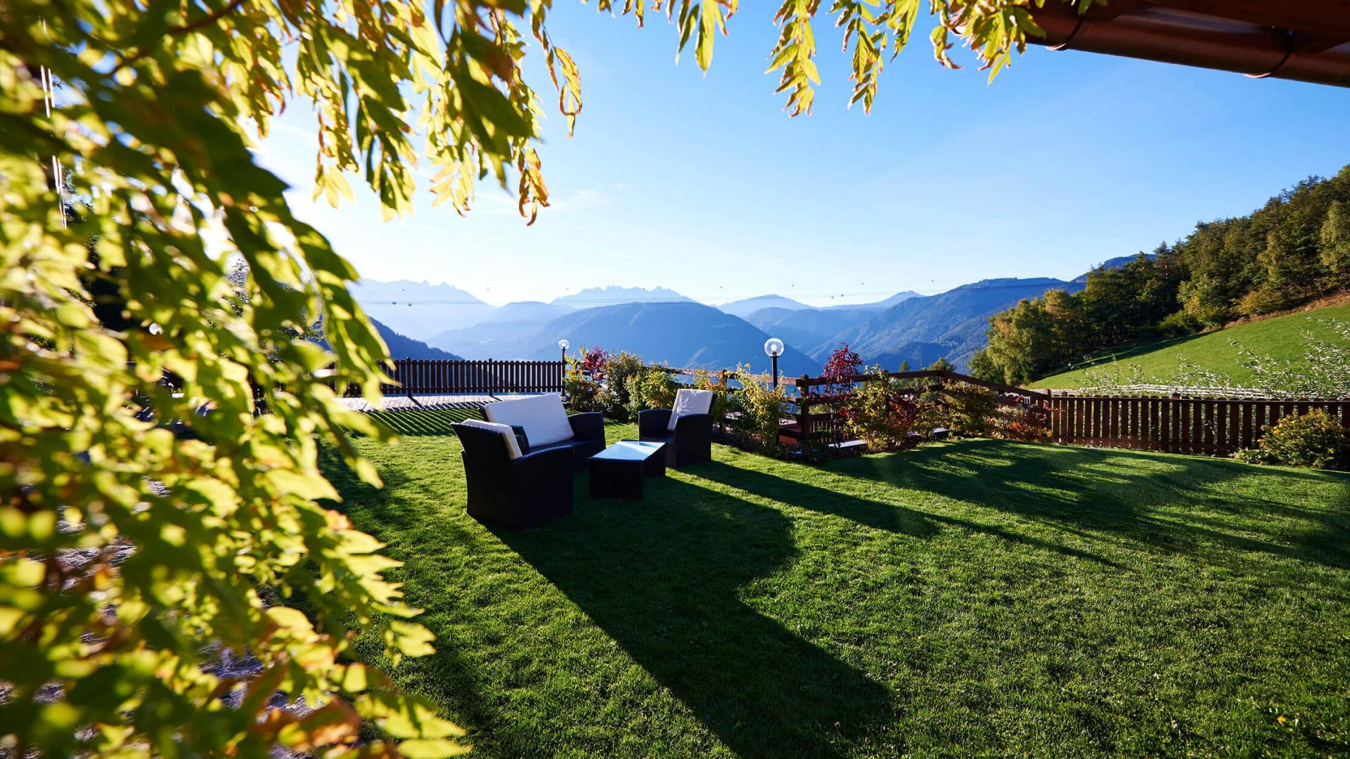 Alpine Lodge Rental in the Dolomites with Wonderful Mountain Scenery a big garden and alpine wellness and spa