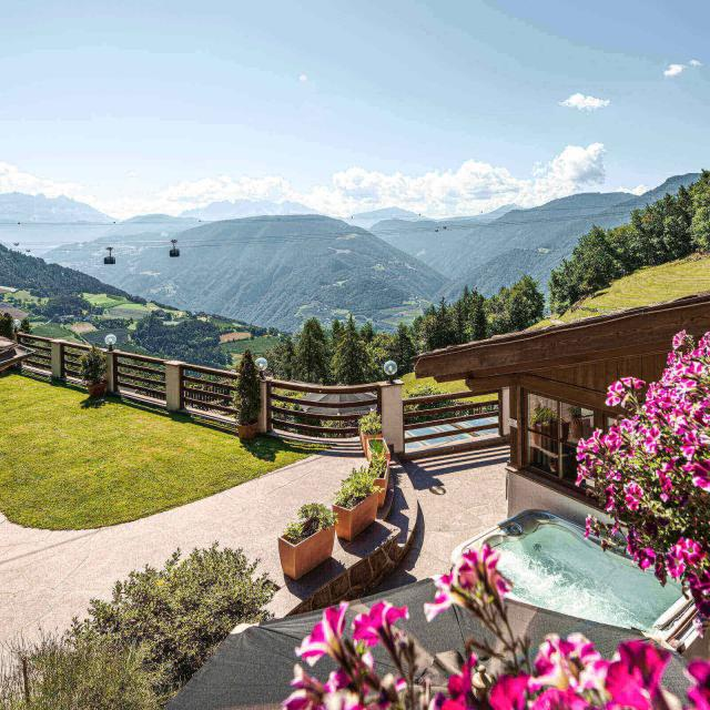 View from Dolomites Suite to the Dolomites and below Superior Suites's terrace with private whirlpool